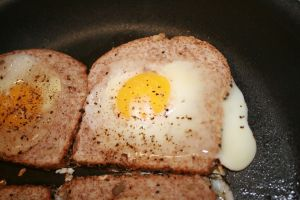 Let the egg cook until it's mostly done to your liking